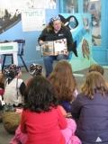 "Reading a pirate story at ""Fins and Flippers Club"""